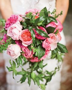 Lush pink garden roses, geranium leaves, and passion vines