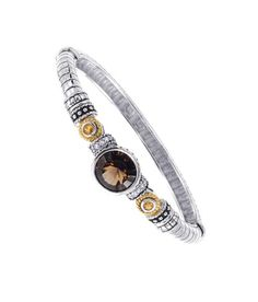 MSRP: $599.99  Our Price: $399.99  Savings: $200.00    Item Number: 141BG111262QSCTWT(4)    Availability: Usually Ships in 5 Business Days    PRODUCT DESCRIPTION:    A Smokey Quartz sits center stage in this expertly crafted bangle bracelet for her. Crafted in fine sterling silver, this beautiful bangle features silver bead accents with 14k yellow gold rope accents that surround Citrine gemstones. This beautiful bangle would make a stunning addition to any jewelry collection!    FEATURES…