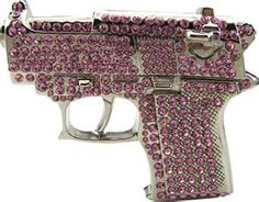 Nothing like a bedazzled hand gun...and I don't even like guns but this one...Fire power with Bling!!! You gotta love it!