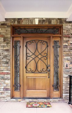 Inglewood Hendersonville Solid Panel Mahogany Door w/ Wrought Iron. Full View Sidelights and Transom w/ Wrought Iron.