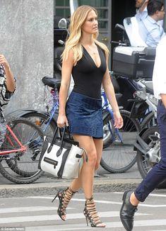 Strutting her stuff: Bar Refaeli looked leggy as she passed through Milan, Italy on Thursd...