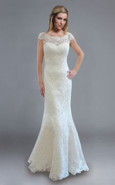 Fitted guipure #lace #wedding dress with cap sleeves from @Megan Herak Trousseau