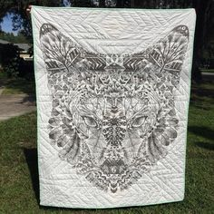 """@clutteredcurator - """"Here is the back of @danceswithsparkles quilt! He is a good coyote. Printed quilt backing from @hawthornethreads #htwipit #coyotefabric"""""""