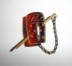 Fantastic Vintage Bakelite Brooch Pin PRYM Fastener Thimble Brass Needle RARE - Collector Note: This is a snapette. on the back is a typical snap device, the chain slips through the garment's loop or hole, such as a sweater, and then snaps on the back. Many are realistic shaped. This appears to be a needle in a thimble.