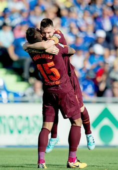 Paulinho of FC Barcelona celebrates with Lionel Messi after scoring his team's 2nd goal during the La Liga match between Getafe and Barcelona at Coliseum Alfonso Perez on September 16, 2017 in Getafe.