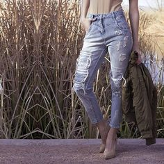 """High Waisted Destroyed Denim Brand new light wash destroyed denim pants with a 5 pocket design and a front zip closure. Made out of 100% Cotton  Model is 5'9"""". Wearing a size small in pictures. Selling a size large which would fit someone who wears a size 7-9 :) Jeans Skinny"""