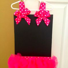 Tutu chalkboard! Paint a canvas with chalkboard paint, use any color tulle and ribbon. Place straps on hanger for perfect toddler height!