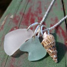 Hawaiian aqua and clear beach glass and gorgeous shell.  Tri-charm silver plated necklace.  :) handmade by me in kailua, oahu, hawaii