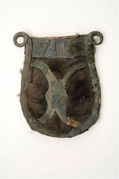 Viking belt pouch. Bronze, fur and paper (missing mounts are replaced with paper). The bronze mountings of a belt pouch are attached to paper fastened onto squirrel fur. Grave find from Björkö, Sweden.