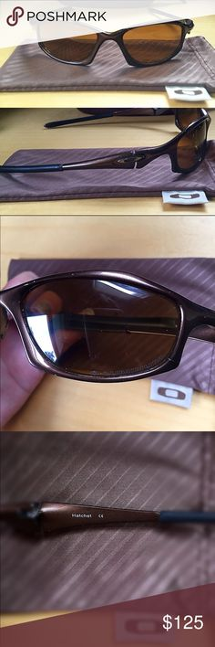 Authentic Oakley Sunglasses!🕶 Used Authentic Genuine Oakley Sunglasses!🕶 Style is Hatchet Wire. Frame is O-luminum Brown. Lens is Titanium Iridium. Style number is 95-882. This style is discontinued so they are hard to find. A few small scratches on the frame (shown in pictures) but otherwise they look good. They are missing the rubber nose covers (can still be purchased) my price will reflect this flaw. Retail was for $285. They include the original cloth bag & a hard Maui Jim case…
