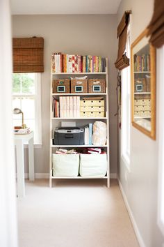 good layout for a helpful bookcase in office... should place mine in same spot in our home office.