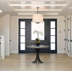 Crisp Foyer design with navy blue front door with frosted glass, beadboard ceiling and white oak hardwood flooring Christian Rice Architects, Inc Restoration Hardware Table, Door Design, House Design, Glass Design, Black Front Doors, Black Door, Dark Doors, Modern Foyer, Entryway Lighting