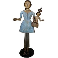 18th Century French Santo Doll:Santo Dolls were originally intended for use for domestic altars for in home worship. They were especially necessary in small villages where there were no priests. Their use reached its height in the 18th and 19th centuries in primarily Catholic countries such as France, Italy and Spain.