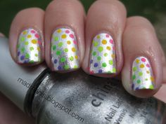 silver with neon polka dot nails.