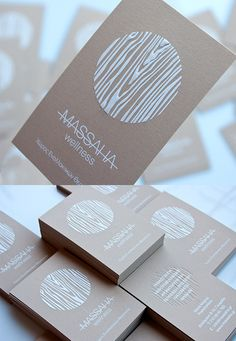 These business cards feature a prominent earthy wood textured logo which has been printed with white ink in an embossed style, helping to draw attention to it.