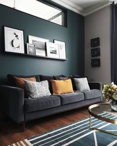 Dark walls, grey velvet sofa, prints on a shelf and mustard cushions in this living room – grey Mustard Living Rooms, Home Living Room, Living Room Inspiration, Dark Grey Couch Living Room, Grey Sofa Living Room, Living Room Paint, Dark Walls Living Room, Living Room Grey, Living Room Decor Gray
