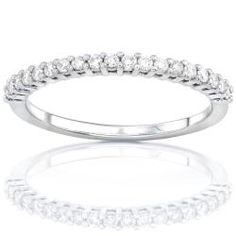 @Overstock - This white gold wedding band makes the perfect compliment to any engagement ring. The 14-karat gold band is encrusted with 0.25 carat of small round-cut brilliant diamonds in prong settings. This ring also makes a great anniversary gift.http://www.overstock.com/Jewelry-Watches/14k-Gold-Womens-1-4ct-TDW-Diamond-Wedding-Band/4712929/product.html?CID=214117 $292.49