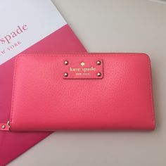 "HP Kate Spade Wallet Gorgeous authentic Kate Spade Neda wallet. Beautiful bright pink color (peony). Zip around continental wallet. Will fit iPhone 6. 14K light gold plated hardware. 12 credit card slots, 3 billfolds, zipper change pocket, exterior slide pocket. 3.9""h x 7.6""w x 0.8d. Any negotiations should be made through the offer button only. Brand new with tags. NO trades please. kate spade Bags Wallets"