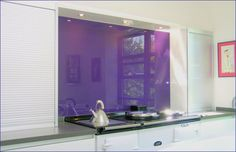 Modern Opticolour Kitchens with blackcurrent Glass Splashbacks