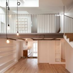 Cairos Architecture uses mezzanine level to create more room inside Paris apartment