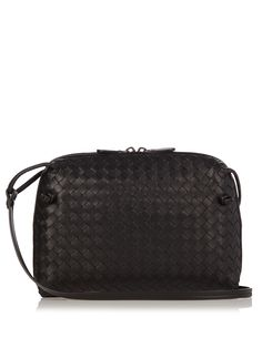 Bottega Veneta's black leather Nodini bag is an elegant choice for everyday. Expertly crafted in Italy using the label's time-honoured intrecciato technique, it's finished with signature knot ends and opens to a soft suede-lined interior that will easily house your phone, makeup compact, and cardholder. Wear it on the shoulder or cross-body.