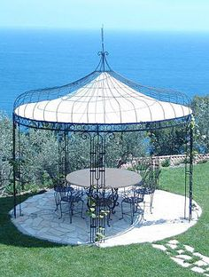 Iron gazebo with canvas roof Iron Pergola, Outdoor Gazebos, Backyard Gazebo, Garden Gazebo, Backyard Retreat, Pergola Patio, Pergola Plans, Pergola Kits, Gazebo Ideas