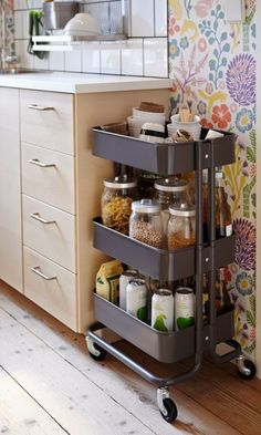 In the kitchen, an IKEA cart acts as a moveable pantry. But it's just as useful in your bathroom, bedroom, and sewing room.