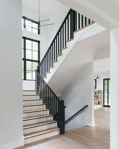 Modern Farmhouse House Tour Black Railing Staircase Modern farmhouse staircase black railing black spindles shiplap The staircase features black spindles and railings to match the black windows Black Staircase, House Staircase, Staircase Railings, Black Railing, Staircase Ideas, Modern Railing, Wood Stairs, Railing Ideas, Hallway Ideas