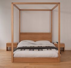 Cube four-poster bed in solid oak. Made in Sheffield by Natural Bed Company. http://www.naturalbedcompany.co.uk/shop/contemporary-beds/cube-modern-four-poster-bed/