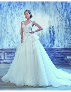 Couture lace ballgown available at Spotlight Formal Wear! #SpotlightBridal