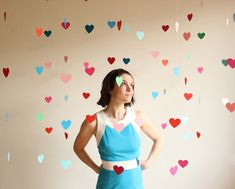 DIY floating heart backdrop! (clear fishing line, heart punch, card stock, regular and painter rape, and scissors); 20 garlands, six hearts each