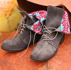 Patterned grey boots.