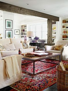 Living Room love all the white and yet also the beam and the rug warm things up a bit, without taking away from the light.