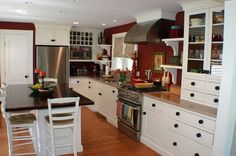 Like the cabinet to the right of the fridge in the foreground. eclectic kitchen design 22