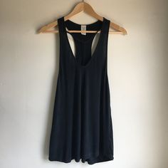 ddf2acbf48ec2 WE THE FREE (FREE PEOPLE) TUNIC TANK Free People black tunic - Depop. More  information. More information. vintage 90s NIKE red HUGE racerback ...