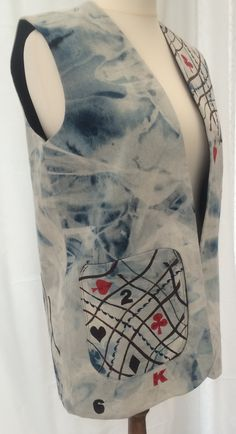 """Ref: 53 long £75.00 Denim distressed blue embroidered playing cards Please check measurements against a garment you wear. To nearest half-inch: Back neck to hem 30"""", Back underarm to underarm 20"""", Side underarm to hem 19.5"""" Each front panel side seam to front opening 10"""", Armhole circumference 22.5"""" further information contact Jackie Wills www.jackiewills.com"""