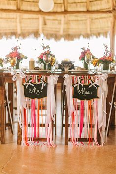 Just love how the chairs are decorated! See the rest of this beautiful gallery: http://www.stylemepretty.com/gallery/picture/1226796/