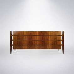 Modern Rosewood Sideboard by William Hinn. https://www.1stdibs.com/furniture/storage-case-pieces/dressers/modern-rosewood-sideboard-william-hinn/id-f_1143108/