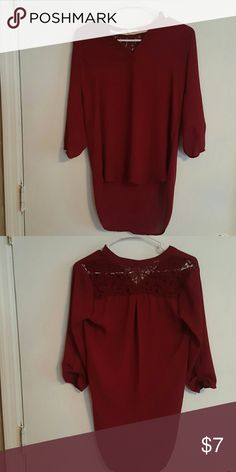 3/4 sleeve top. Loose fitting. Crochet design on back. Tops Blouses