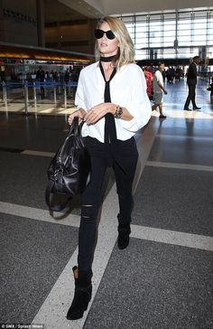 Coming through: Rosie looked like a rock star as she wore a white blouse with a black scarf and ripped jeans