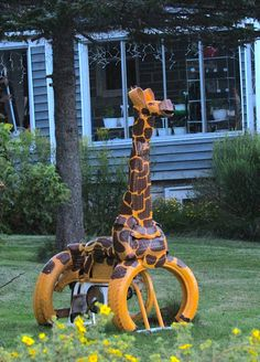 A giraffe created from a stationary bike and old recycled tires, perfect for the kids! Une girafe créée à partir d'un vélo stationnaire et de vieux pneus recyclés. https://youtu.be/c_K2RSWbR1I…