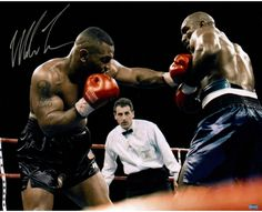 Mike Tyson Signed Punching Holyfield 16x20 Photo Legendary boxer Mike Tyson personally hand-signed this 16x20 Photo. Mike Tyson commonly called Iron Mike was one of the most feared and fearsome men to