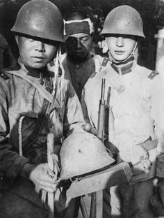 Japanese soldiers show off the bullet-pocked helmet that saved the life of their comrade (center) during the Battle of Beiping (Beijing)-Tianjin of the Second Sino-Japanese War. The Battle of Beiping-Tianjin was actually a series of battles of fought in the proximity of Beijing and Tianjin, China between Imperial Japanese forces and Chinese forces and would result in a Japanese victory. With the fall of Beijing and Tianjin, the North China Plain was helpless against the Japanese divisions wh...