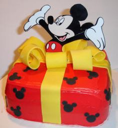 Mickey Mouse birthday cake...jumping out of a present