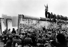 <b>Carol Guzy (1956–)</b><br>News photographer for The Washington Post. She has won the Pulitzer Prize four times—one of four people to do so, and the only journalist with that achievement. <em>The fall of the Berlin Wall 25 years ago, for The Washington Post.</em>