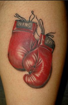 Boxing Gloves Tattoo with maiden name and with my pink bow and measuring tape