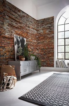 An exposed brick wall in a room doesn't always mean industrial. Moreover if we talk about the specific white brick wall, the style and design it suits will be way more than just one kind. Orange Brick, White Brick Walls, Exposed Brick Walls, Exposed Brick Apartment, Exposed Brick Kitchen, Black Brick Wall, Orange Red, Brick Interior, Interior Design