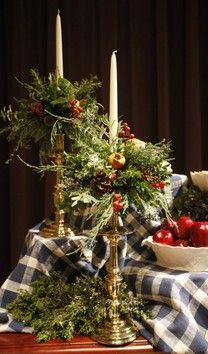 Brass, greenery, tartan plaid and bright red apples and a pop of white tapers. Perfect!