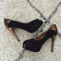 """Guess Peep Toe Platform Heels Go glam in these worn once suede and metallic back pumps!  4.5"""" heel. Black suede with gold snakeskin metallic detail down back and all of heel. Black bottoms in almost perfect condition. Guess Shoes Heels"""