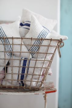 lavender pillows made from antique European grain sacks.  Nice display in wire basket